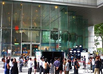 Singapore Fines Credit Suisse, UOB