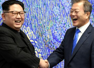 File picture of Kim Jong-un (L) and Moon Jae-in at the truce village  of Panmunjom, South Korea.