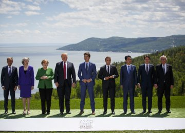 From left: Donald Tusk, Theresa May, Angela Merkel, Donald Trump, Justin Trudeau, Emmanuel Macron, Shinzo Abe, Giuseppe Conte, and Jean-Claude Juncker  during the G7 Leaders Summit in Canada on June 8.