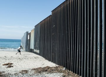 Trump has pledged that Mexico will pay for the wall, which could cost up to $21.5 billion. The picture shows a section of the  wall separating Mexico and the US, in Tijuana, Mexico.