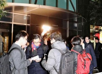 Concerned users outside Coincheck headquarters  in Tokyo on Friday.