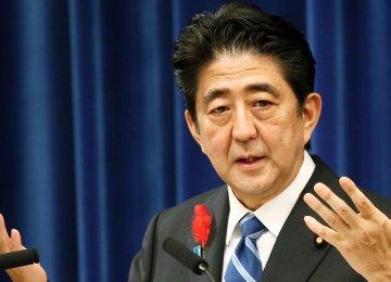 Abe Sticks to Tax Hike Plan