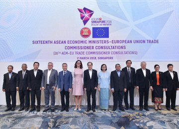 EU Trade Commissioner Anna Cecilia Malmstrom (6th from L) posing for a group photograph with economic ministers  from the ASEAN during the 24th ASEAN Economic Ministers' Retreat in Singapore on March 2.