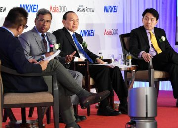 (From right) ST Engineering President & CEO Vincent Chong, Top Glove Executive Chairman Lim Wee Chai, and HCL Technologies Corporate Vice President & Head, APAC Business, Swapan Johri at the summit in Singapore on Thursday.