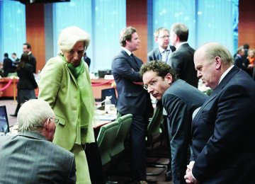 Jeroen Dijsselbloem (2nd R) says Greece's reforms need to be credible.