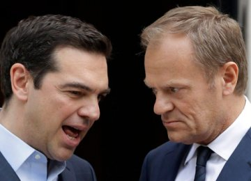 Greek PM Alexis Tsipras (L) and European Council President Donald Tusk in Athens.