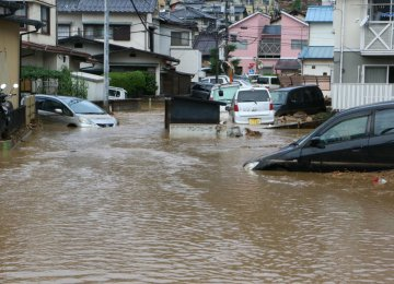 Floods and landslides swept the western part of Japan, leaving the government with $2.44 billion bill  to rebuild areas destroyed by the disasters.
