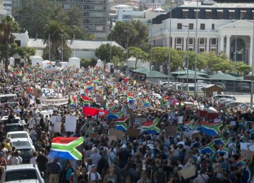Protesters call for the president to step down on April 7, in Cape Town.