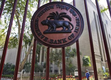RBI Keeps Rate Unchanged, Downgrades Growth Forecast