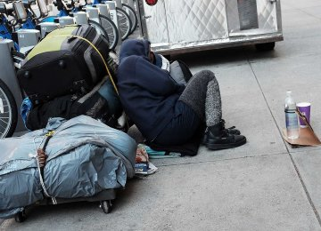 A homeless woman on the street in New York City.