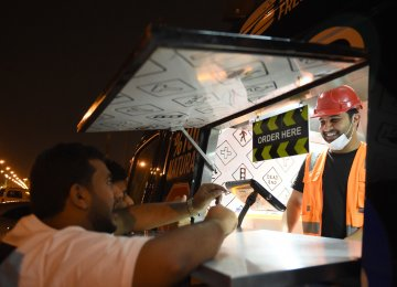 """Dishing out burgers and fries slathered with melted cheese, """"One Way Burger"""" is like any other trendy food truck in Riyadh."""