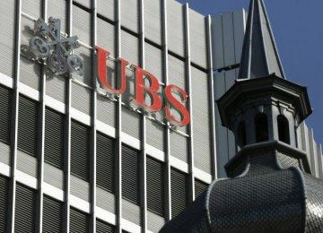 UBS Annual Net Profit Halves