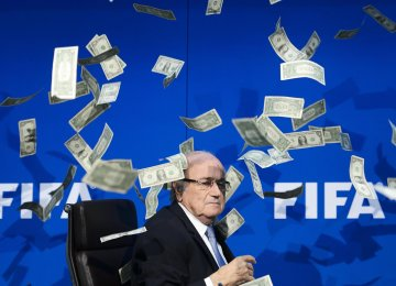 "Sepp Blatter was showered with fake money by British comedian Lee Nelson at 2015 FIFA press conference, Zurich. ""Sepp, this is for North Korea in 2026"" said Nelson while throwing money to blatter, accusing him of bribery in FIFA."