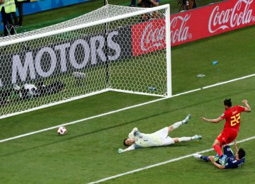 Belgium's Nacer Chadli scores his team's third goal in the 94th minute to beat Japan 3-2.