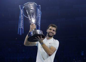 Grigor Dimitrov with the ATP Finals trophy