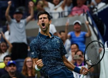 Djokovic, Federer Cruise Into US Open 4th Round