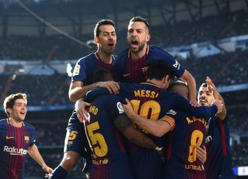 Barca squad celebrate their win at rival's home.
