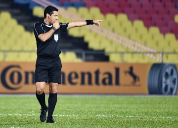 Alireza Faghani started his career in 1994 and became a FIFA referee in 2008.
