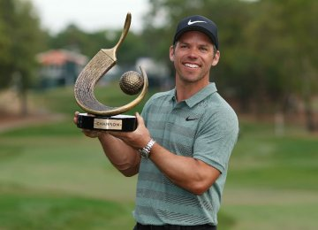 Paul Casey poses with the trophy after winning the Valspar Championship golf tournament  at Innisbrook Resort.