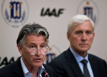 President of the IAAF Sebastian Coe (L) speaks next to the head of the IAAF's Russian taskforce team Rune Andersen.