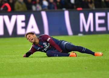 Neymar was taken off after injuring his ankle against Marseille at Parc des Princes.