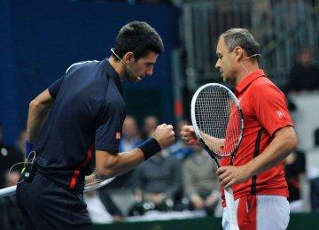 Novak Djokovic (L) had parted ways with his coach Marian Vajda last May.