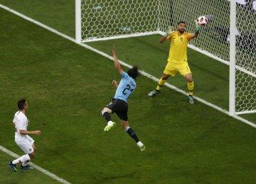 France, Uruguay Reach Last 8