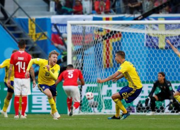 Sweden's Emil Forsberg (No. 10) celebrates scoring his side's only goal against Switzerland.