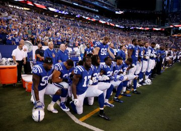 Indianapolis Colts players kneel during the playing of the national anthem at Lucas Oil Stadium last September.