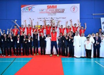 The team celebrates winning the title.