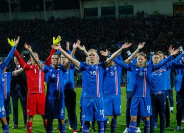 Iceland's players celebrate after reaching the World Cup finals.