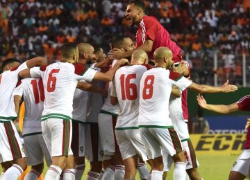 Morocco national team players celebrate their first World Cup appearance after 20 years.