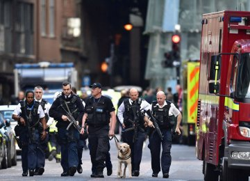 A group of police officers walk in London streets, on June 6, a few days after a terror attack on London Bridge and at Borough Market that killed seven people.