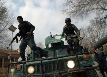 Afghan security forces surround Kabul's Sardar Daud Khan Hospital on March 8.