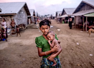 12 year old Oma Salema with his brother in a camp for Rohingya in Sittwe, Myanmar (File Photo)