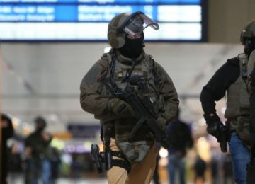 Special police commandos arrive at the main train station  in Dusseldorf, western Germany, on March 9.