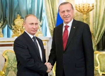 Russian President Vladimir Putin (L) and Turkey's President Recep Tayyip Erdogan meet at Kremlin, Moscow, on March 10.