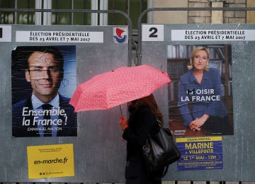 Posters of presidential candidates Emmanuel Macron (L) and Marine Le Pen