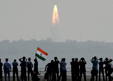 Onlookers watch the launch of satellites at Sriharikota, India, on Feb. 15.