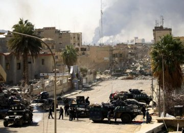 Iraqis Recapture Mosul State Buildings From IS