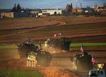 A convoy of US forces armored vehicles drives near the village of Yalanli,  on the western outskirts of the northern Syrian city of Manbij, on March 5.