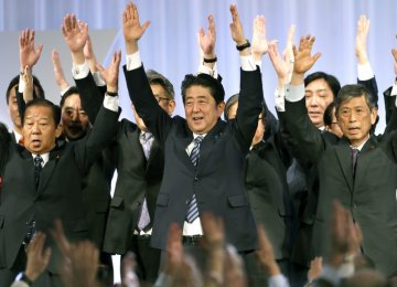 Japanese Prime Minister Shinzo Abe (C) celebrates with lawmakers and members at the ruling Liberal Democratic Party's annual convention at a hotel in Tokyo, on March 5.