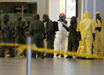 Hazmat crews at work in the main hall of Kuala Lumpur International Airport 2 in Sepang, Malaysia, on Feb. 26