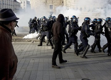 Riot police face off protesters in Nantes, France, on Feb. 25.