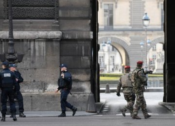 French police officers and soldiers patrol in front of the Louvre museum in Paris, France, on Feb. 3.