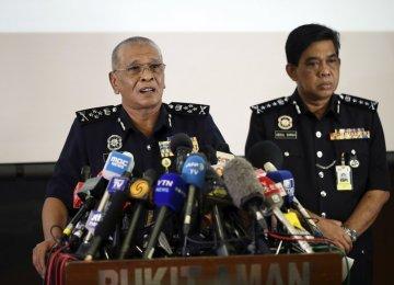 Noor Rashid Ibrahim (L) speaks in Kuala Lumpur, Malaysia, on Feb. 19.
