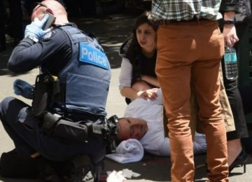 A victim receives help at the scene in Melbourne,  Australia, on Jan. 20.
