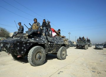 Iraqi security forces advance toward the village of al-Buseif on February 21, during their offensive to retake western Mosul.