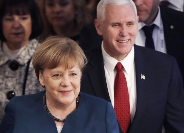 German Chancellor Angela Merkel (L) and the United States Vice President Mike Pence attend the security conference  in Munich, Germany, Feb. 18.