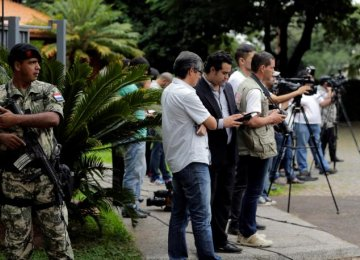 Journalists seen outside the presidential residence during a meeting of senators, deputies, governors and local leaders with Paraguay's President Horacio Cartes in Asuncion, Paraguay, on April 3.